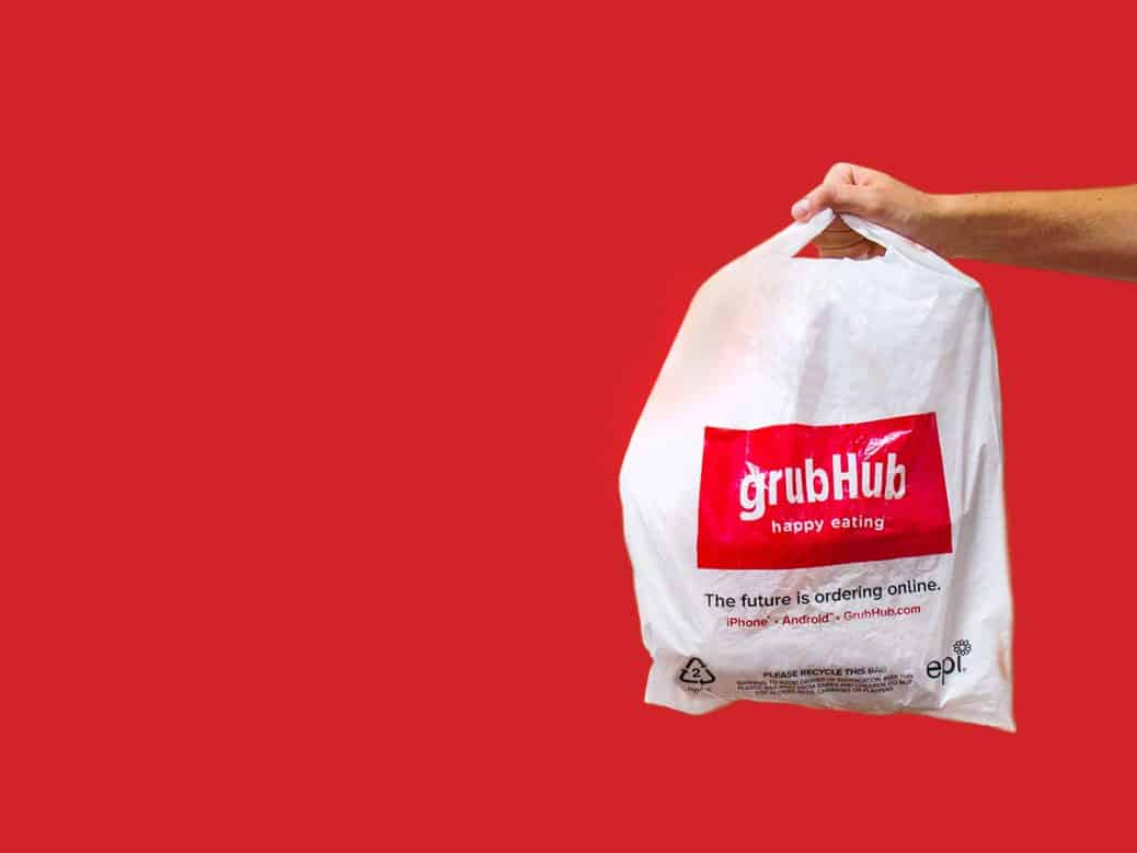 hand holding bag with grubhub label on it