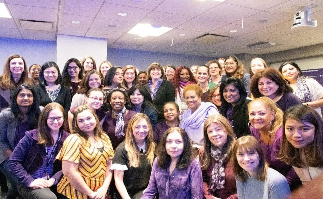 TIAA female senior business leaders pose as a group during TIAA's IWD kickoff event