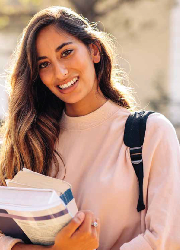 Latina college student smiling carry books and a backpack