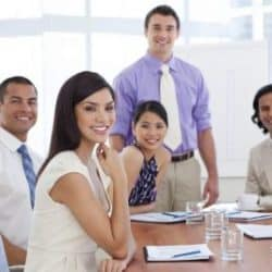 successful women and men in a business meeting