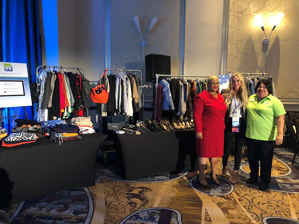Lena Graham-Morris is presented a donation of over 750 items of business attire and accessories