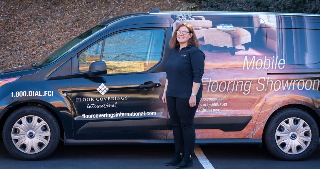 Kris Piotrowski poses outside in front of her work vehicle
