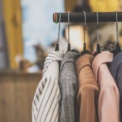 A clothes rack with women's coats hanging on it